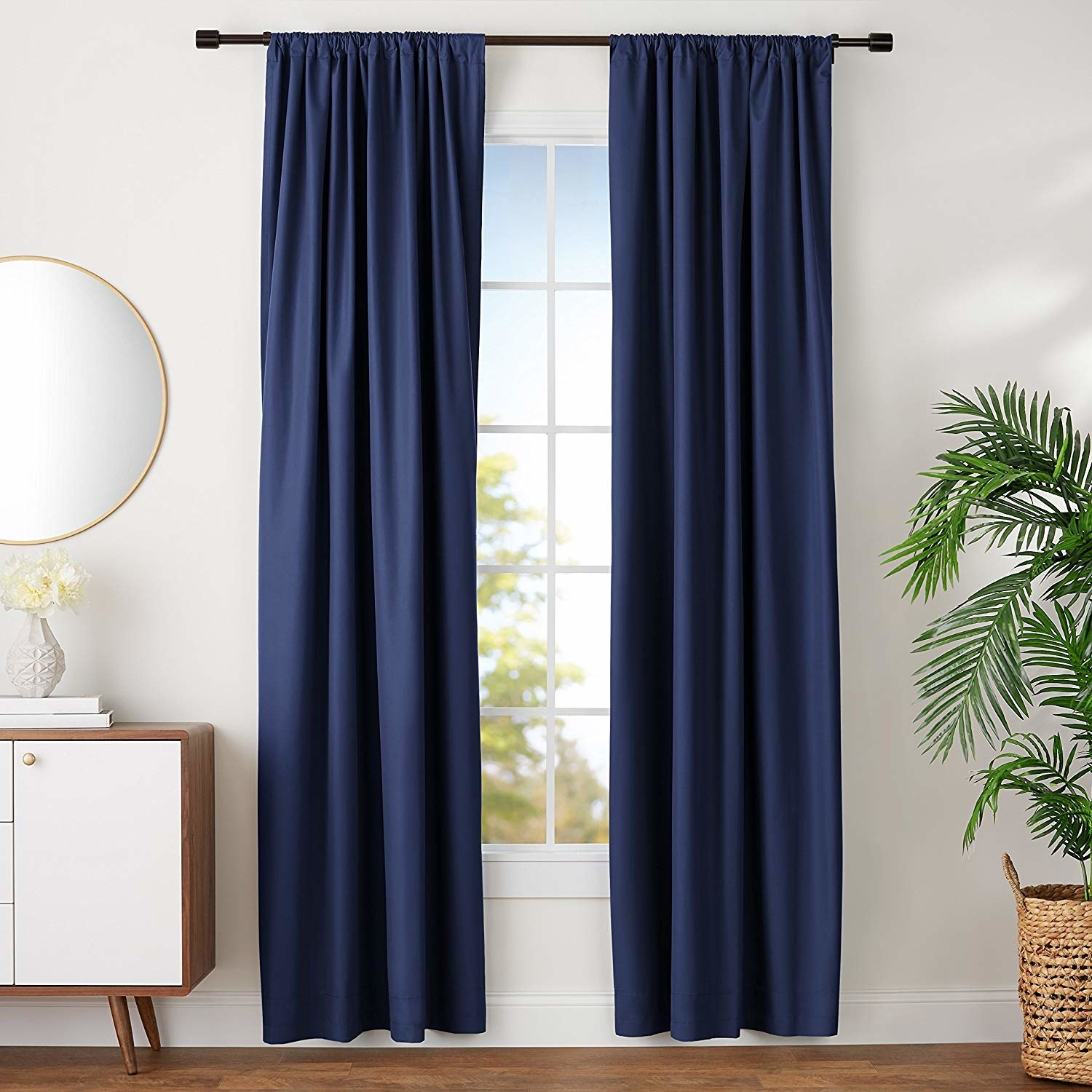 The panels in navy, reaching from above the window to one or two inches off the ground