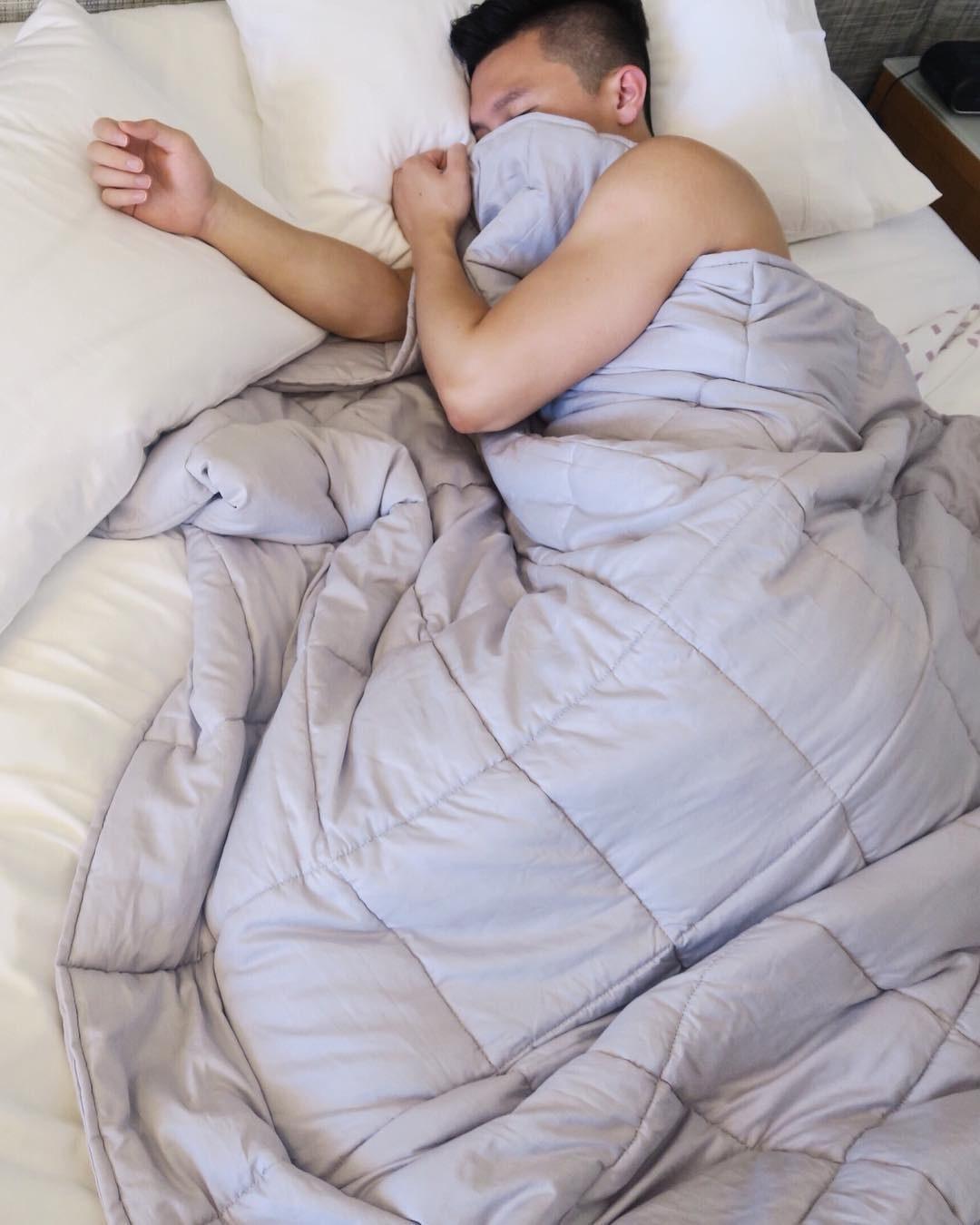 Model sleeping under the blanket