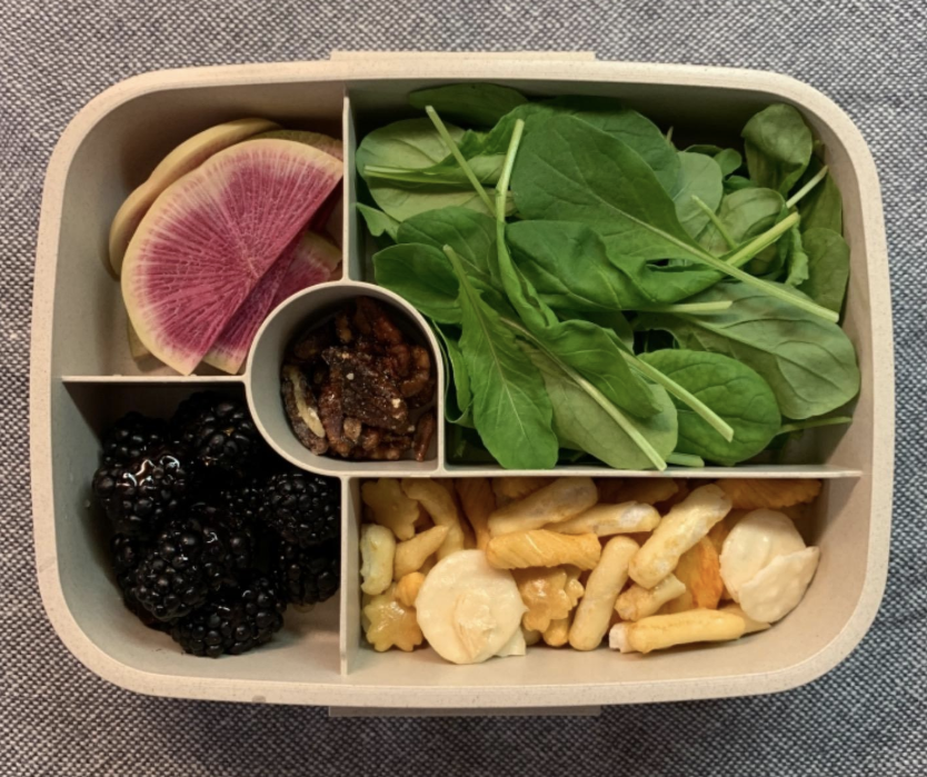 A reviewer photo showing a top-down view of the bento box filled with different food in each compartment