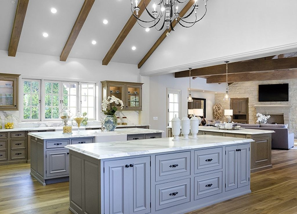 a well-lit kitchen with wooden beams