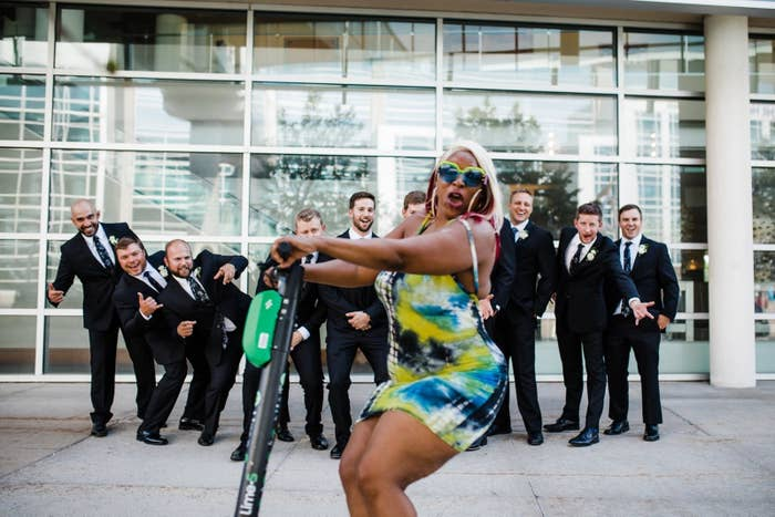 """This Wedding Party Got Photobombed By """"Scooter Girl"""" And They Loved Every Second Of It"""