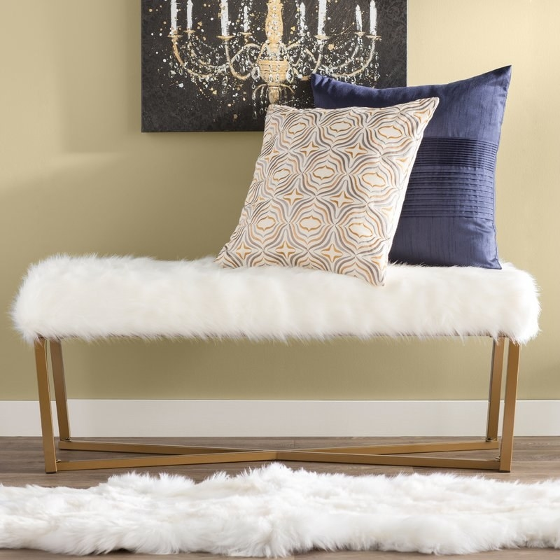 bench with white faux fur on it
