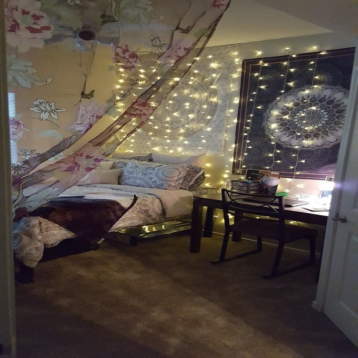 The lights hanging above a bed