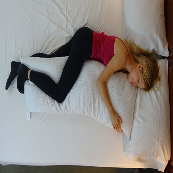 model sleeping with the long, narrow body pillow