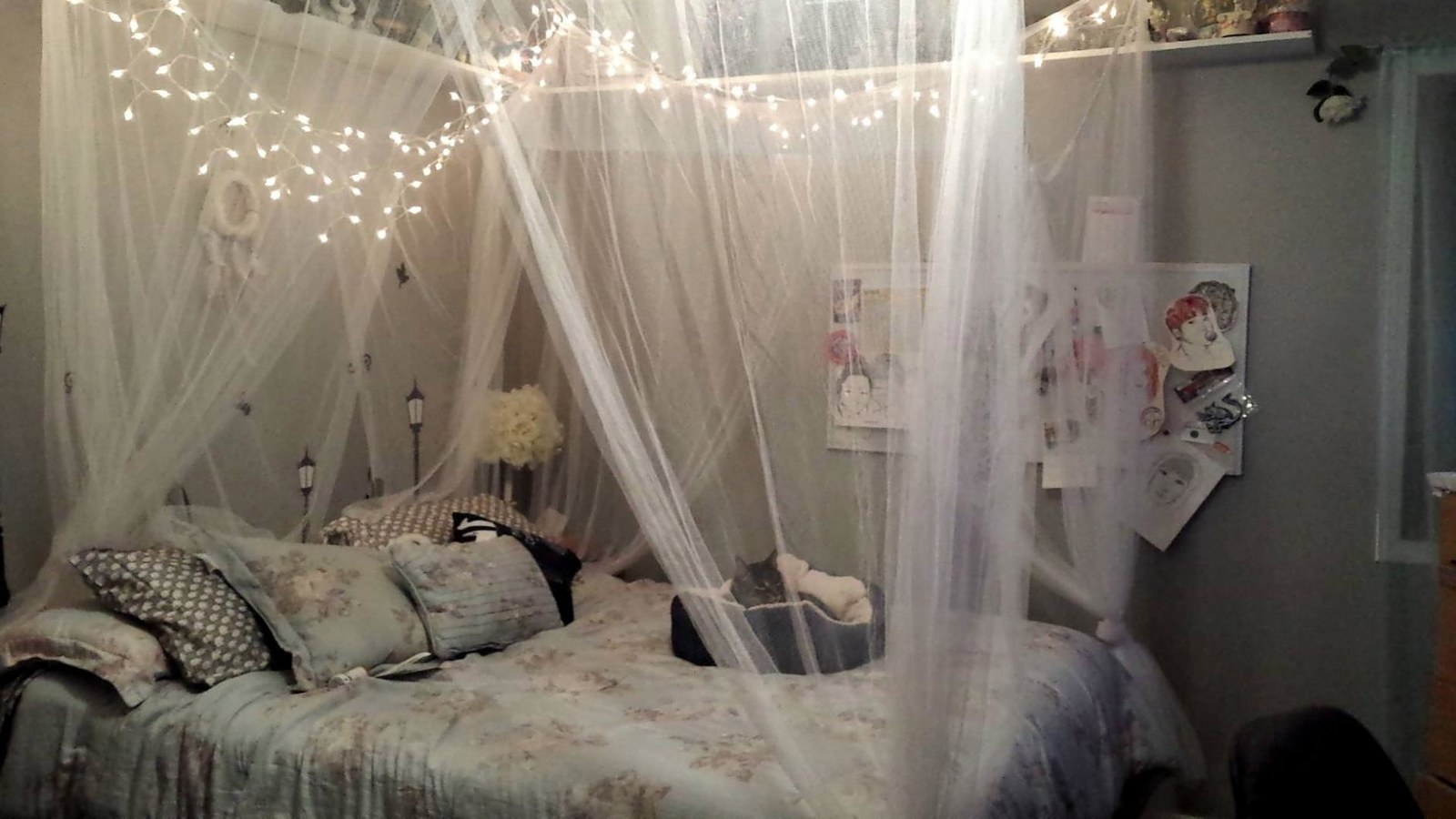 the canopy over a bed against the wall