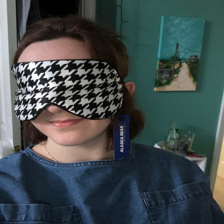 person wearing the mask in a houndstooth print