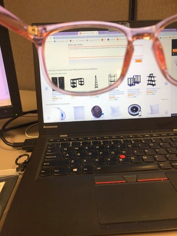 Reviewer photo showing that the glasses change the color of their computer screen
