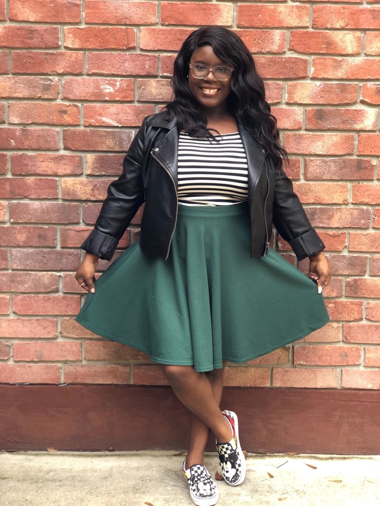 Reviewer wearing the knee-length skirt in green
