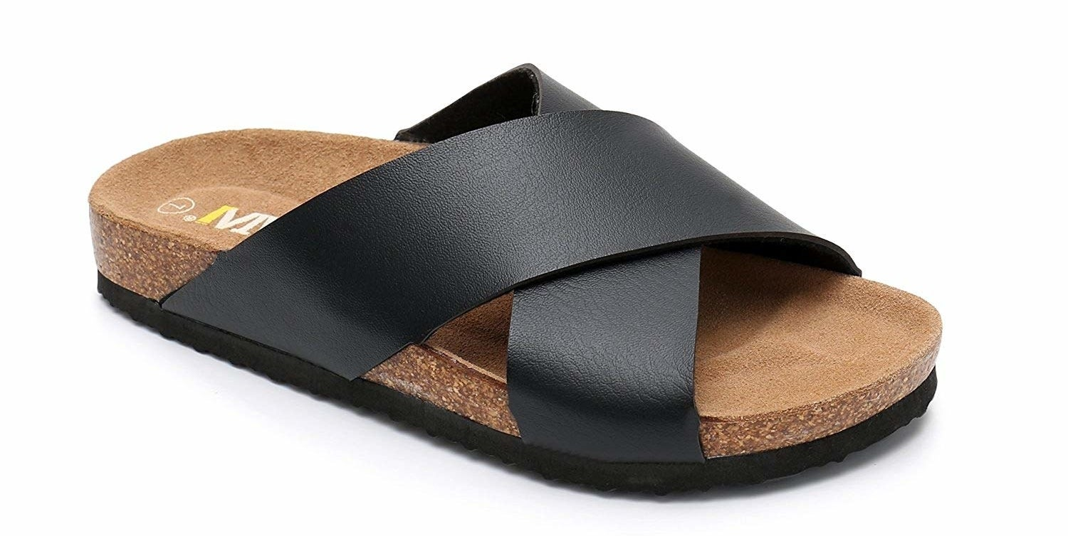 A cork bottom slide with black criss-cross straps