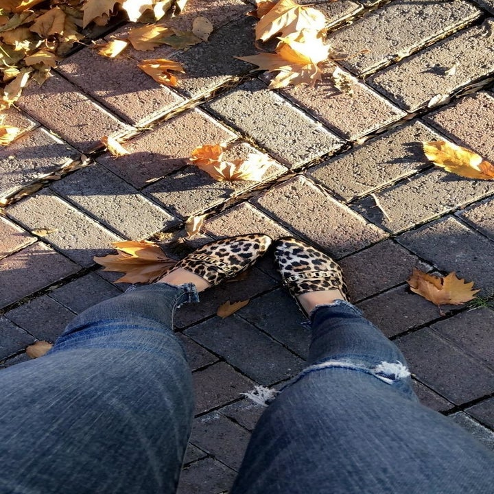 reviewer wearing the loafer in leopard print