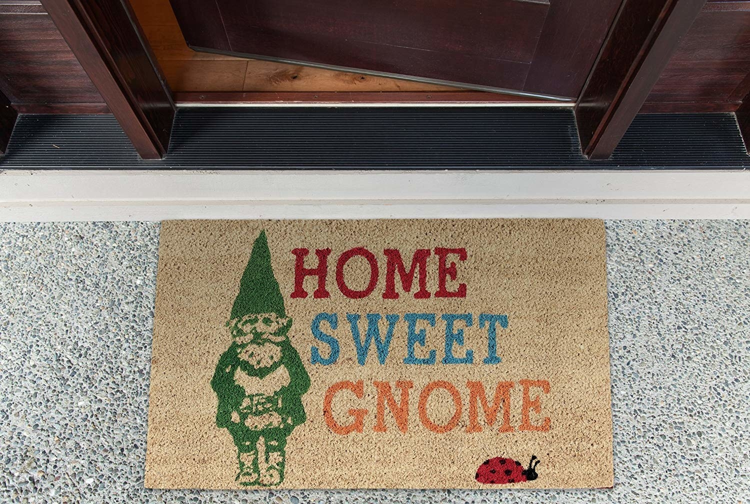 a welcome mat that says home sweet gnome and has a gnome and ladybug