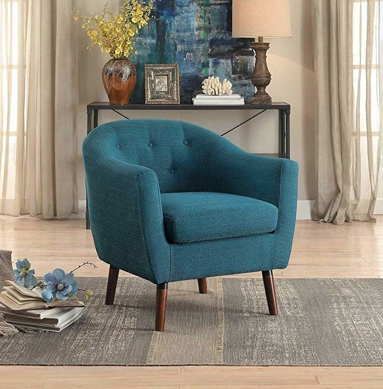 plush blue chair with wooden legs