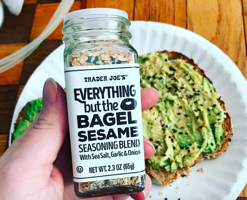"reviewer hand holding clear bottle labeled ""Trader Joe's everything but the bagel"""