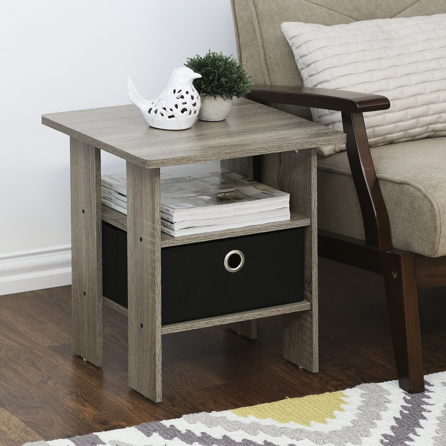 The side table with two shelves and a fabric bin in one shelf