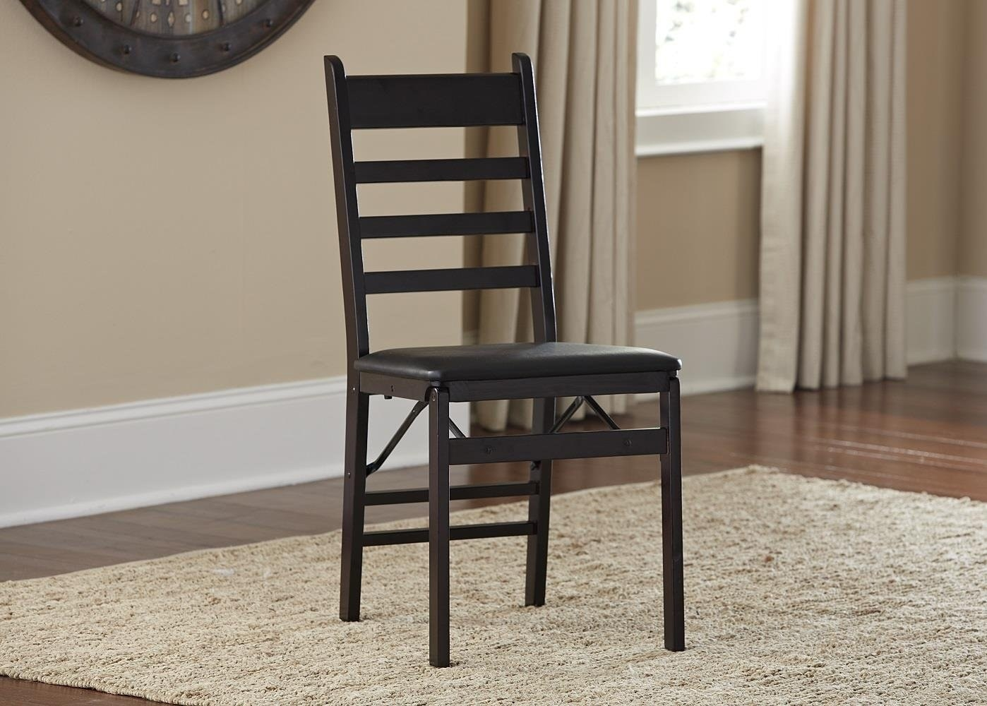The chair in brown with a ladder-style back in a room