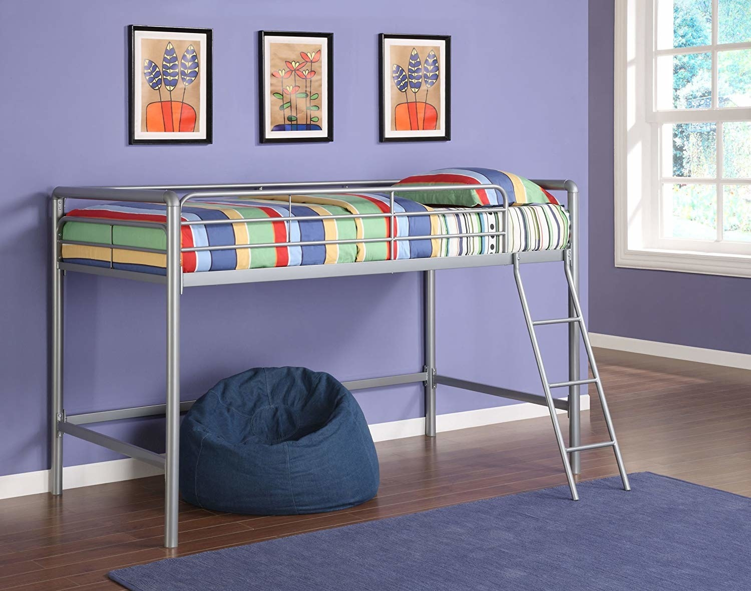 The silver twin-sized loft bed frame in a room with a beanbag chair underneath