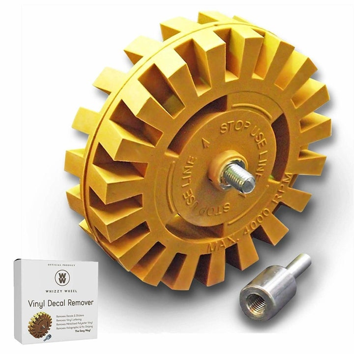 The bright yellow wheel with an attachment for going on a drill