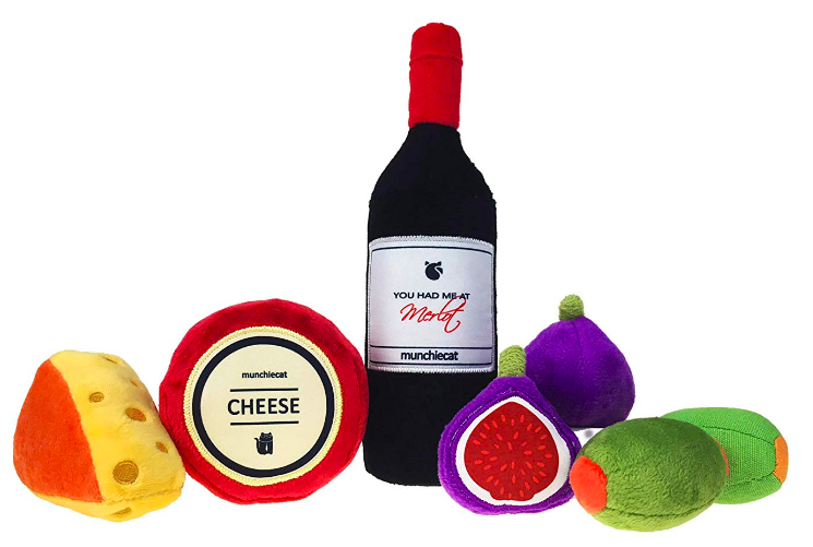 Plush wine bottle, two cheeses, two figs, and two olives