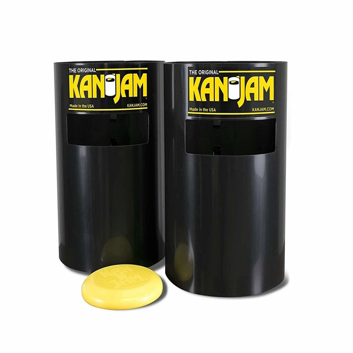 """a pair of black plastic tubes with a slot cut out towards the top of it designed so you can throw a frisbee through it. each tube says """"kan jam"""" in yellow letters"""