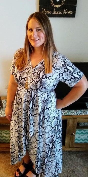 reviewer wears snake skin pattern short sleeve dress
