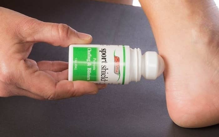 Hand rolling on the anti-blister bottle directly onto the achilles