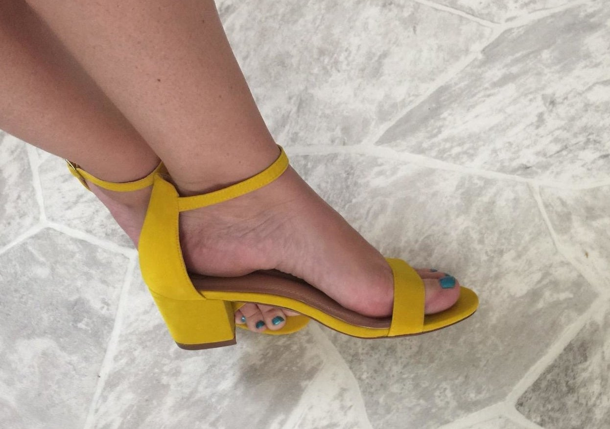 reviewer wearing the heels in yellow