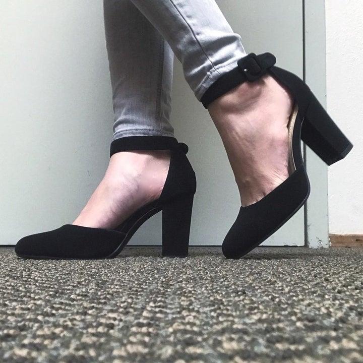 reviewer wearing the heels in black