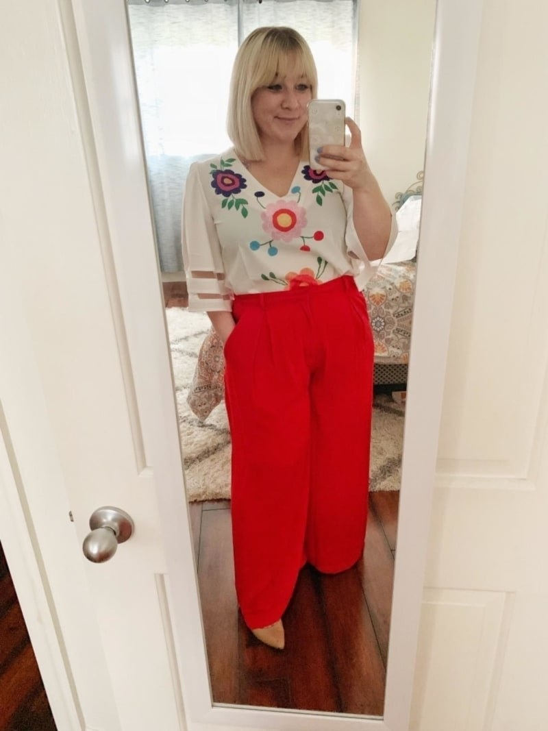 reviewer wearing the trousers in red