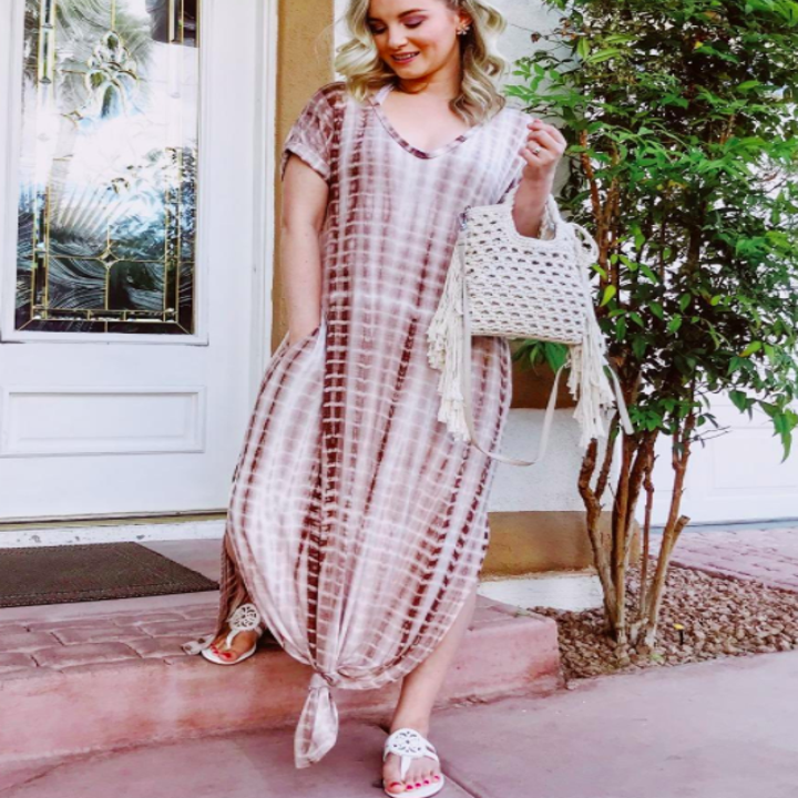 A customer review photo of the dress in coffee