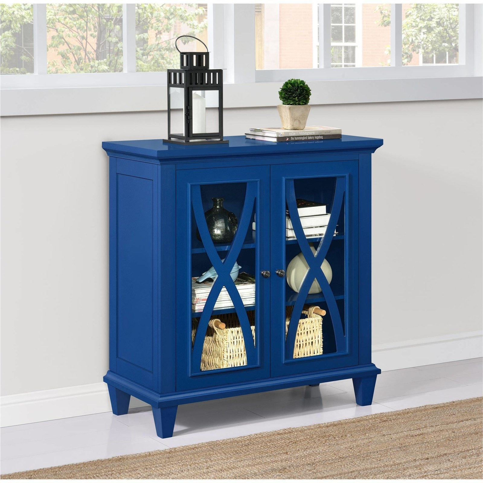 cobalt cabinet with windows and cross wood over the glass