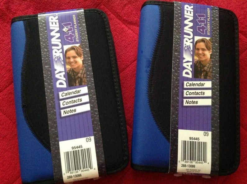 A photo two black and blue day planners.