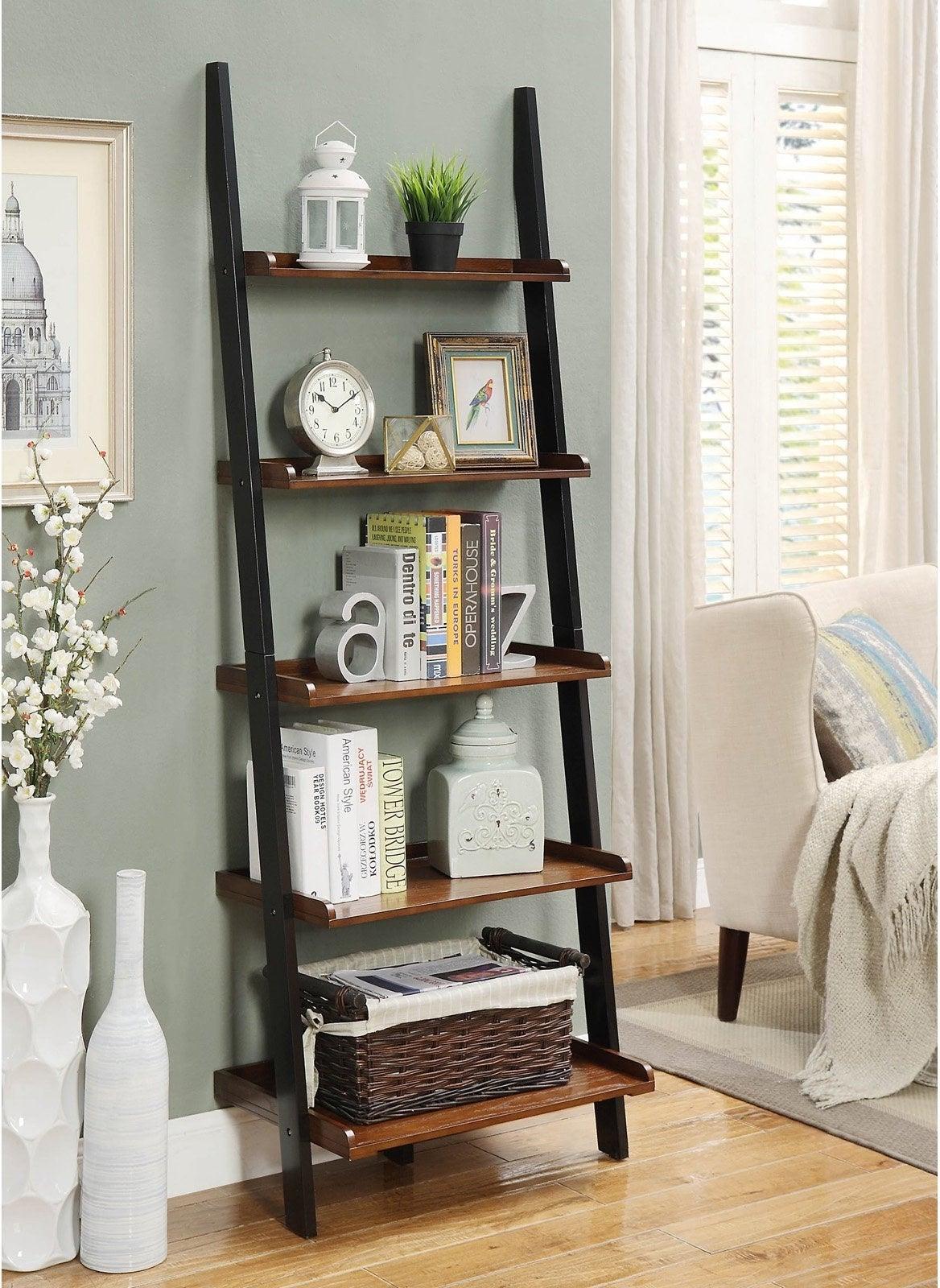 black and dark wood leaning bookshelf