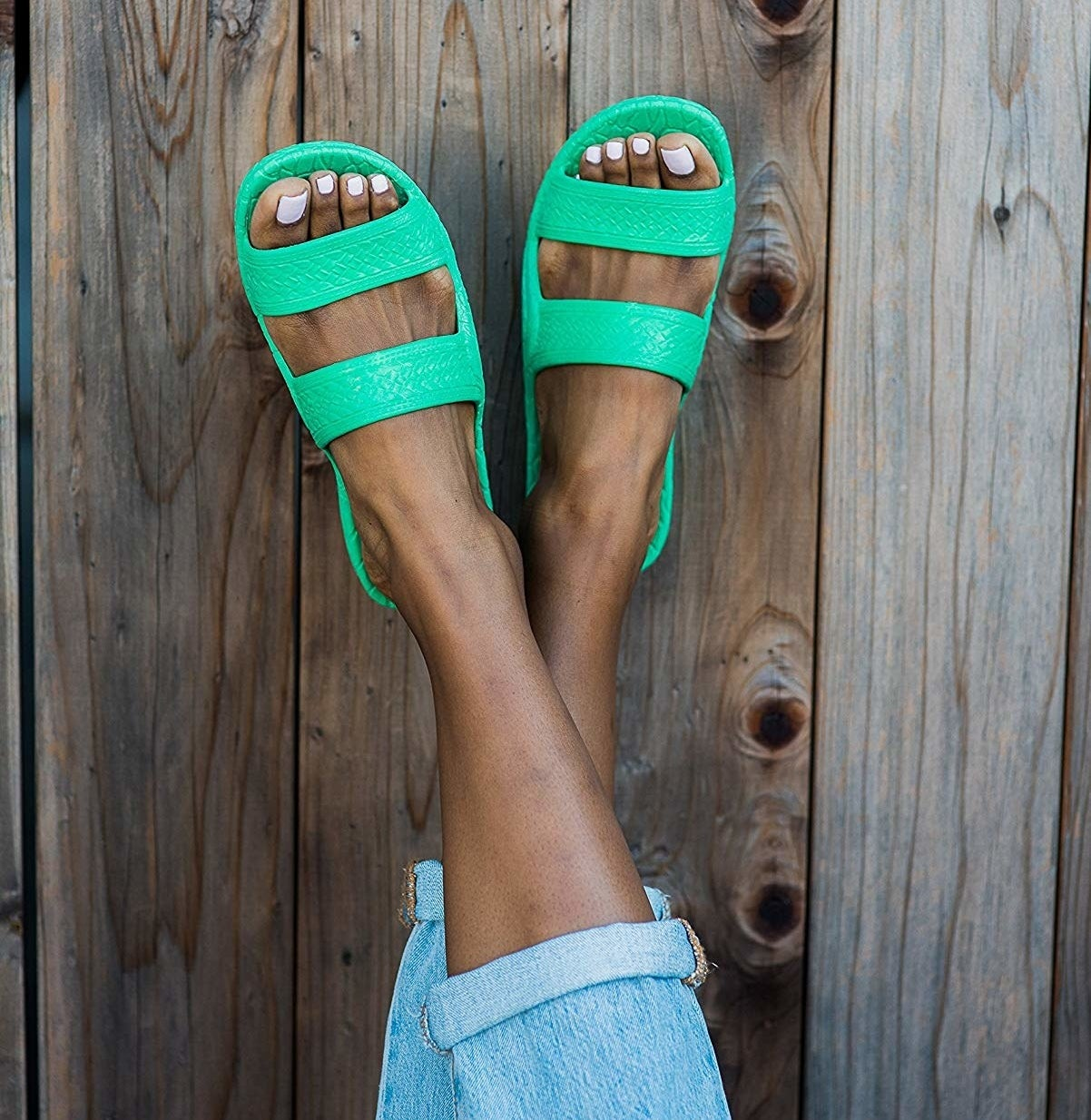 model wearing slides in spring green color