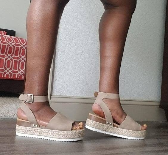 reviewer wearing sandals in taupe