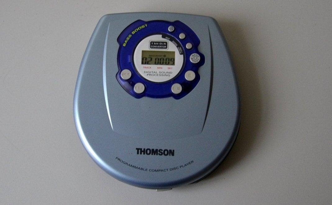 A photo of a grey portable CD player.