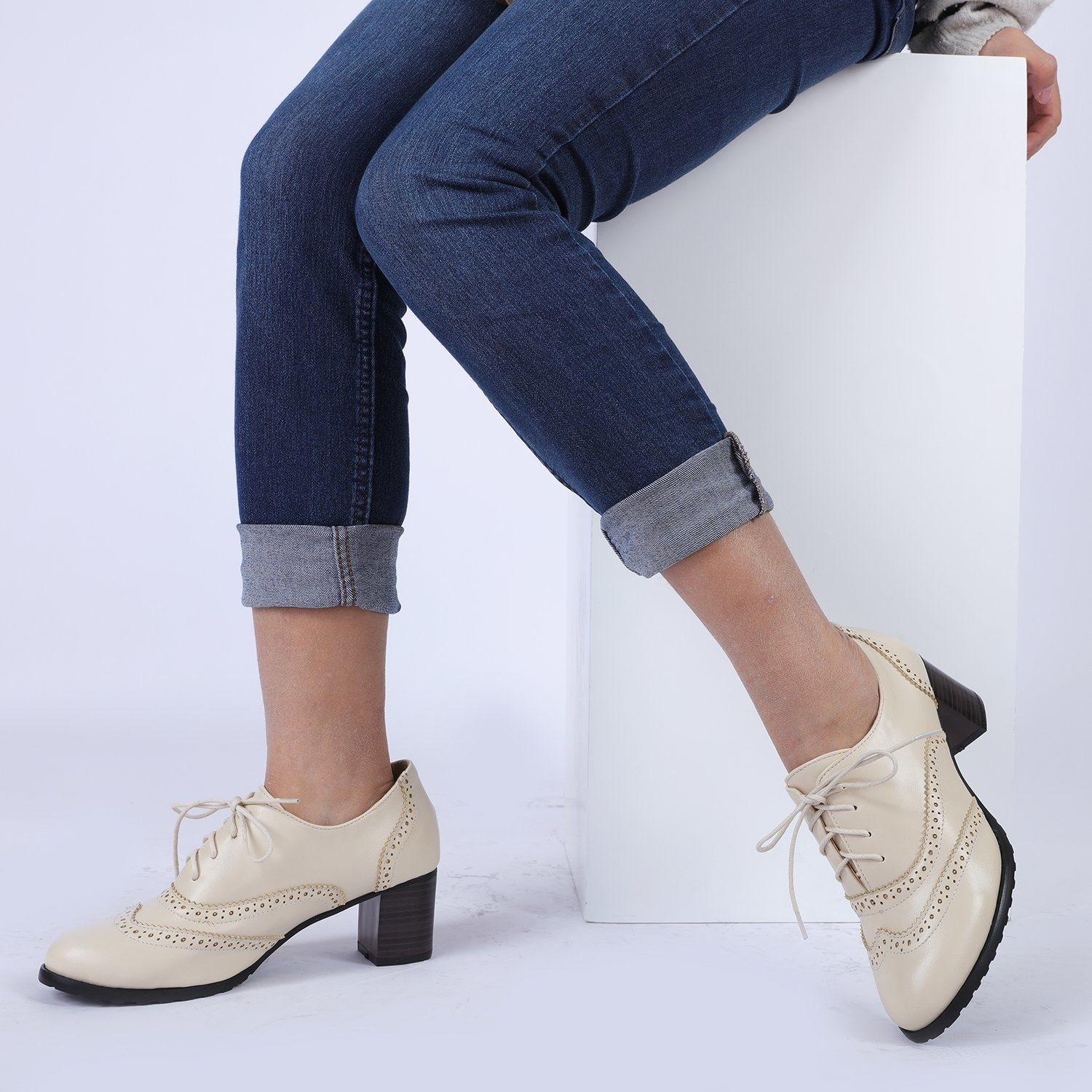model wears oxford shoes in beige