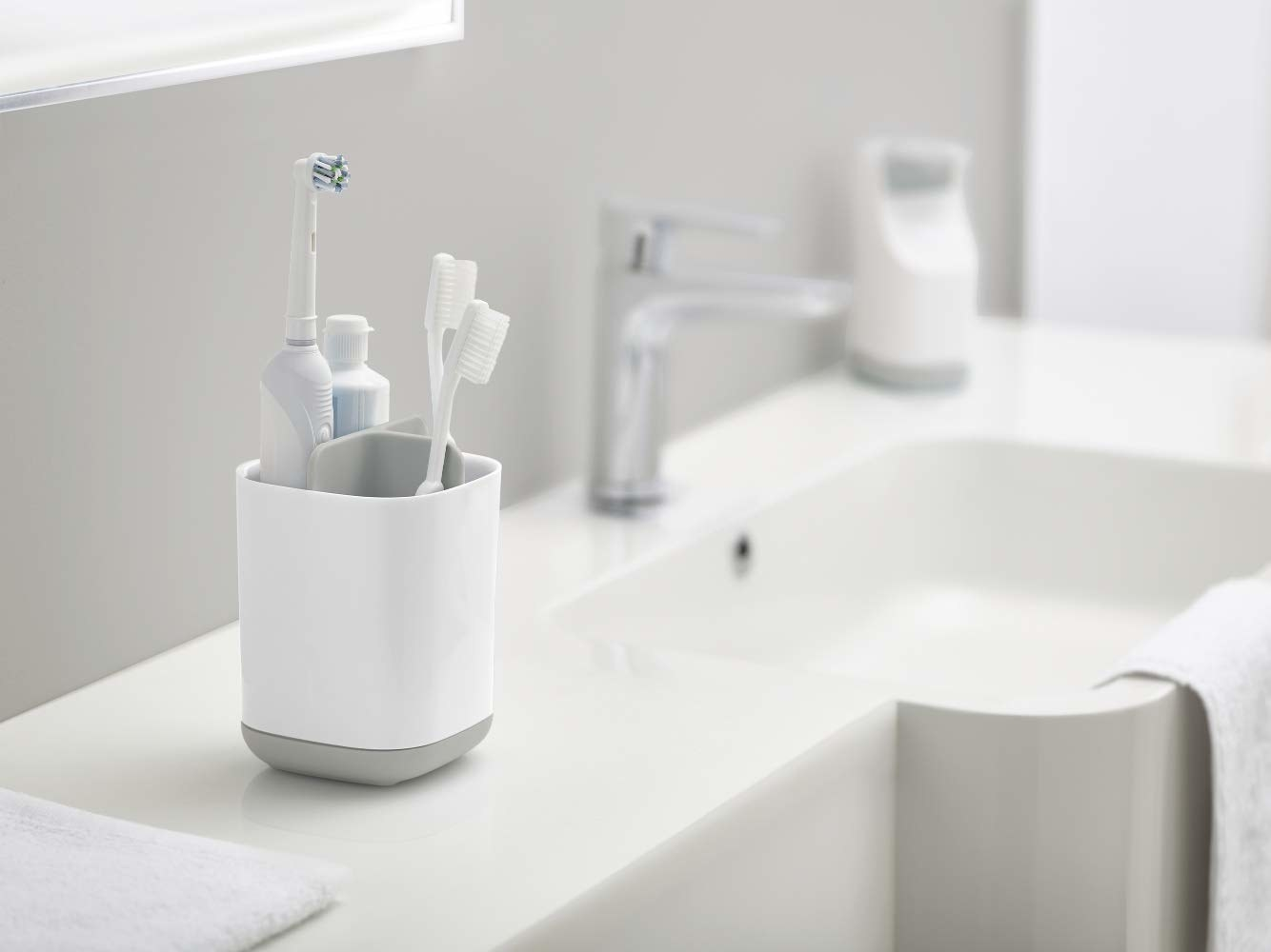 The toothbrush caddy with toothbrushes in it