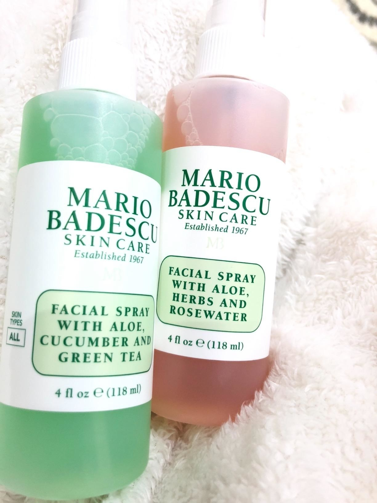reviewer's bottles of the green and pink spray