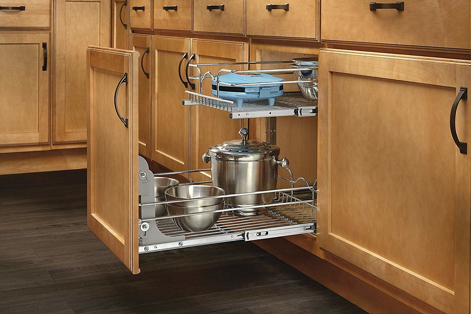 lower kitchen cabinet with front of cabinet door attached to a pullout rack for small appliances