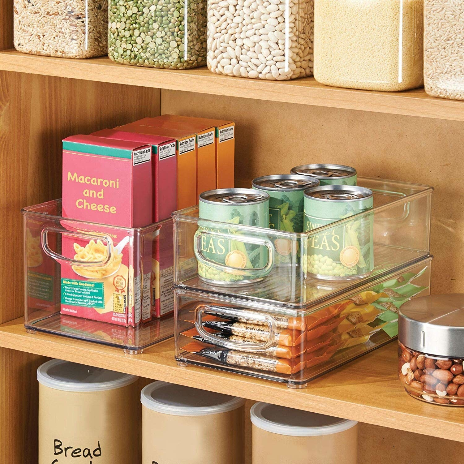 pantry shelves with clear open container on shelves used to organize stuff like mac and cheese boxes and cans of peas