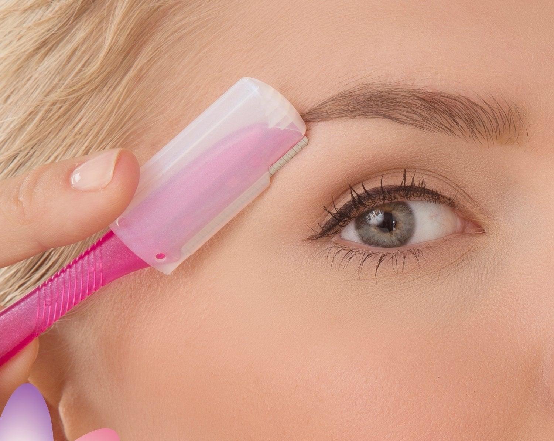 model uses straight razor with plastic guard