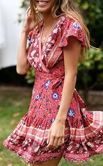 a model wearing the dress in red with floral print and flutter sleeves