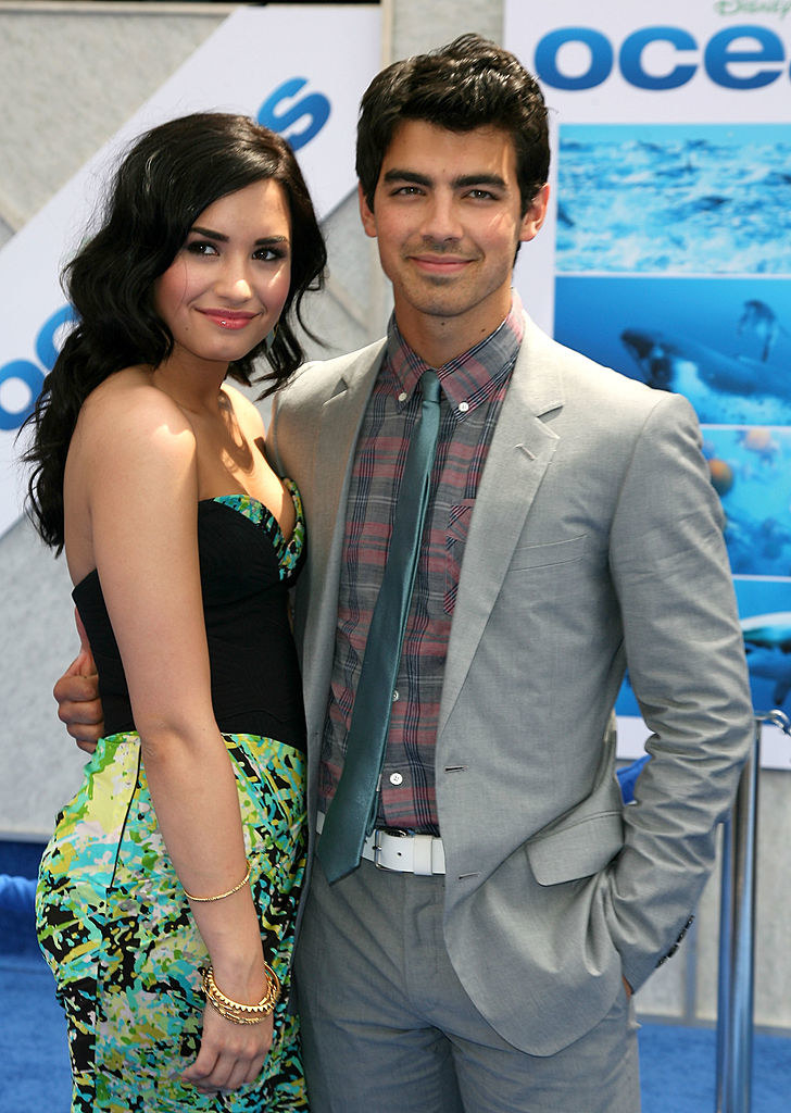 demi in floral pants posing with joe