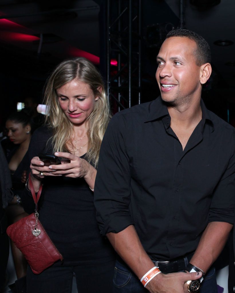 A-rod next to diaz checking her phone