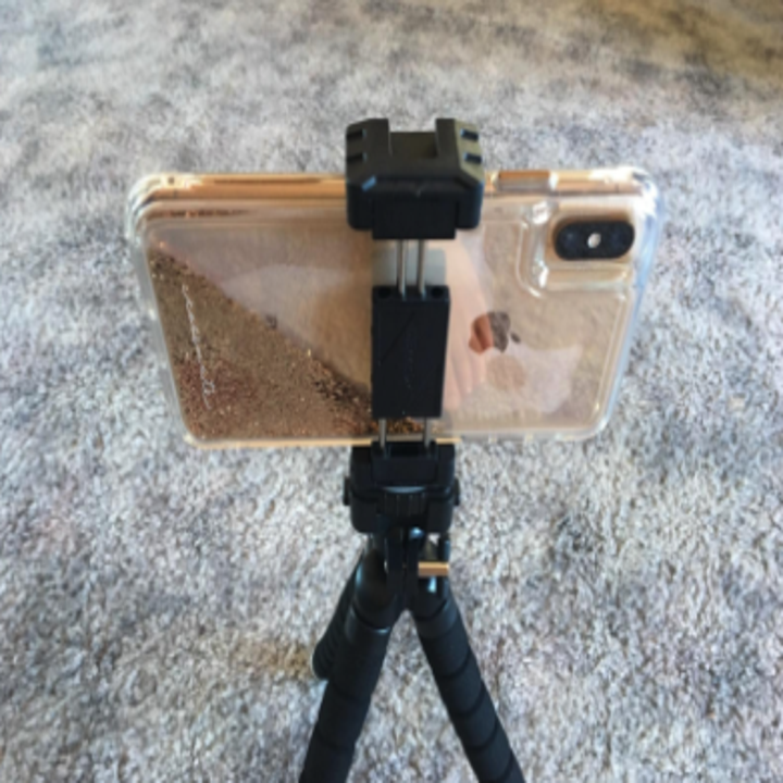 a reviewer's phone clipped into the tripod