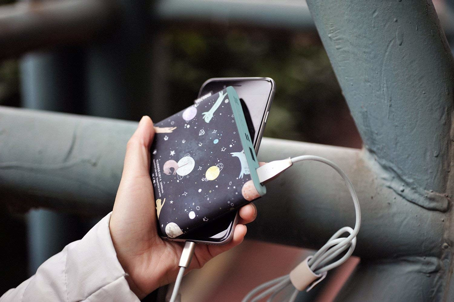 a portable charger with a galaxy design on it