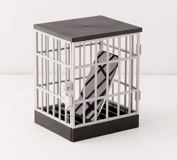 a phone inside a cage with a lock