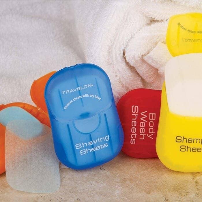 collection of shaving sheets, body wash sheets, and shampoo sheets