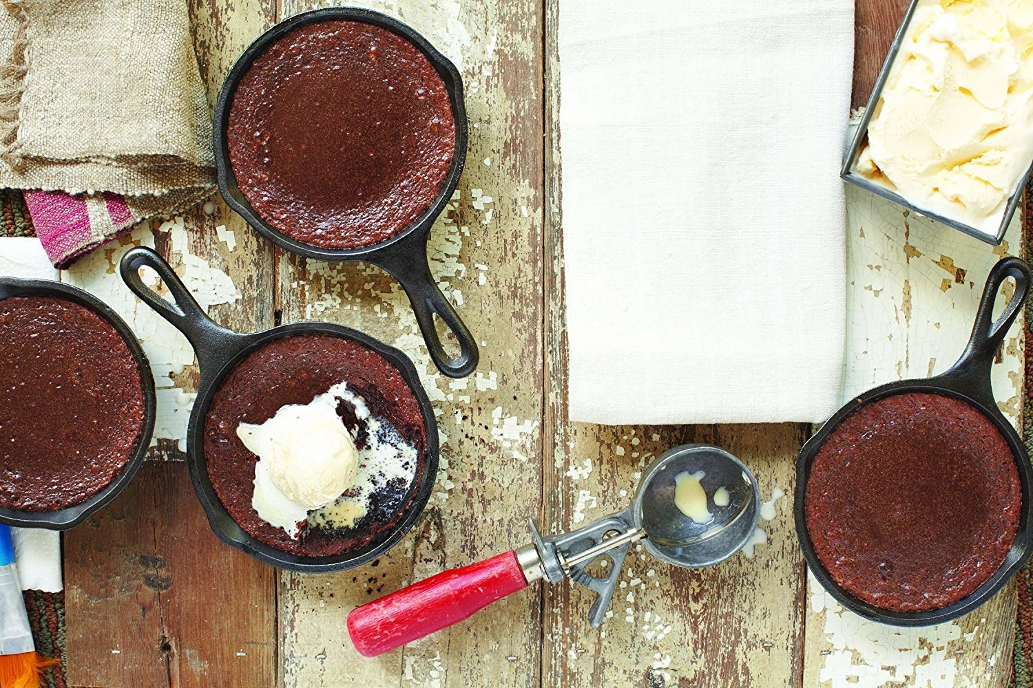 Brownies and ice cream in small skillets