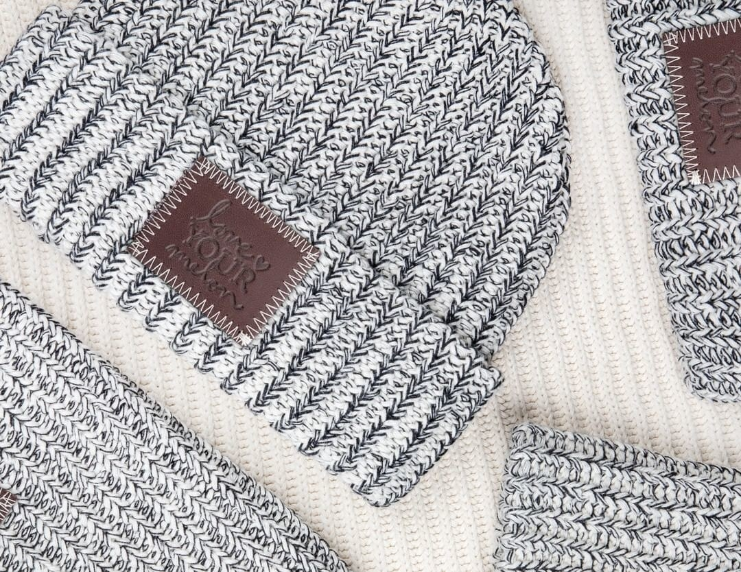 a grey and white speckled beanie